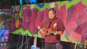 Jayden Paz performing at an iHuman event.