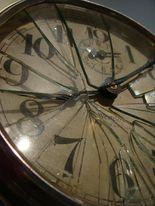A close up of a broken clock.