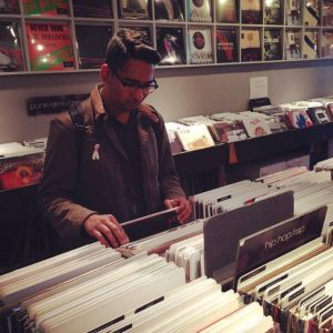 DJ Gulzar searching through records at the record store.